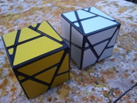 Skewb Ghost Cube (golden and silver).
